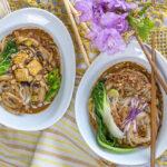 Delicious Dan Dan Noodles with Tofu & Mushrooms in modern white bowls