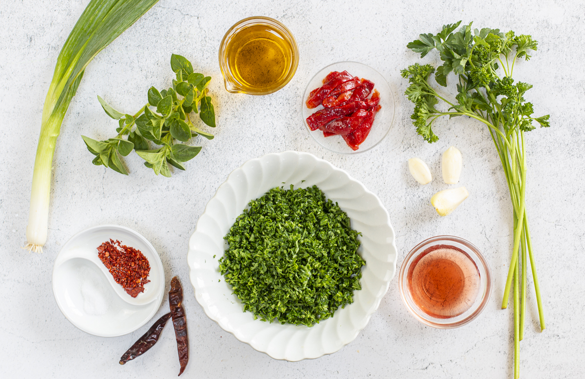 Simple ingredients for the Chimichurri Sauce on a marble board