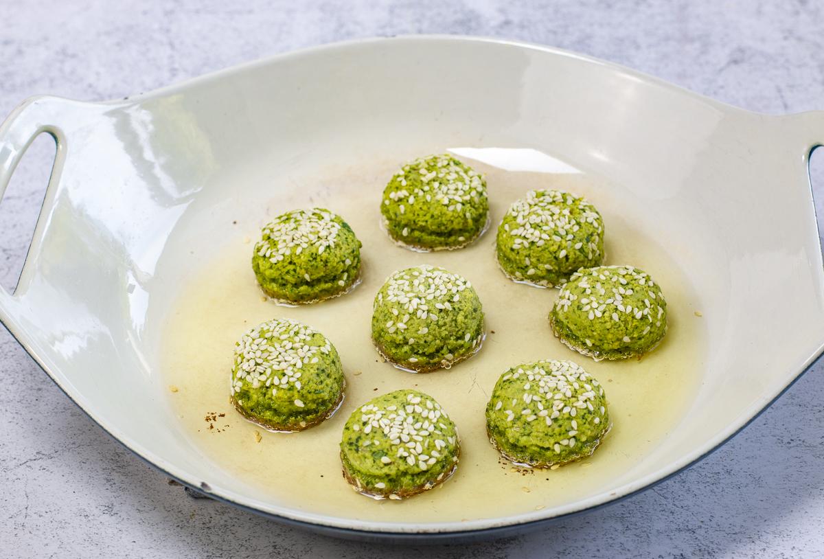 Cook the first side of falafel until deep golden brown, then flip over