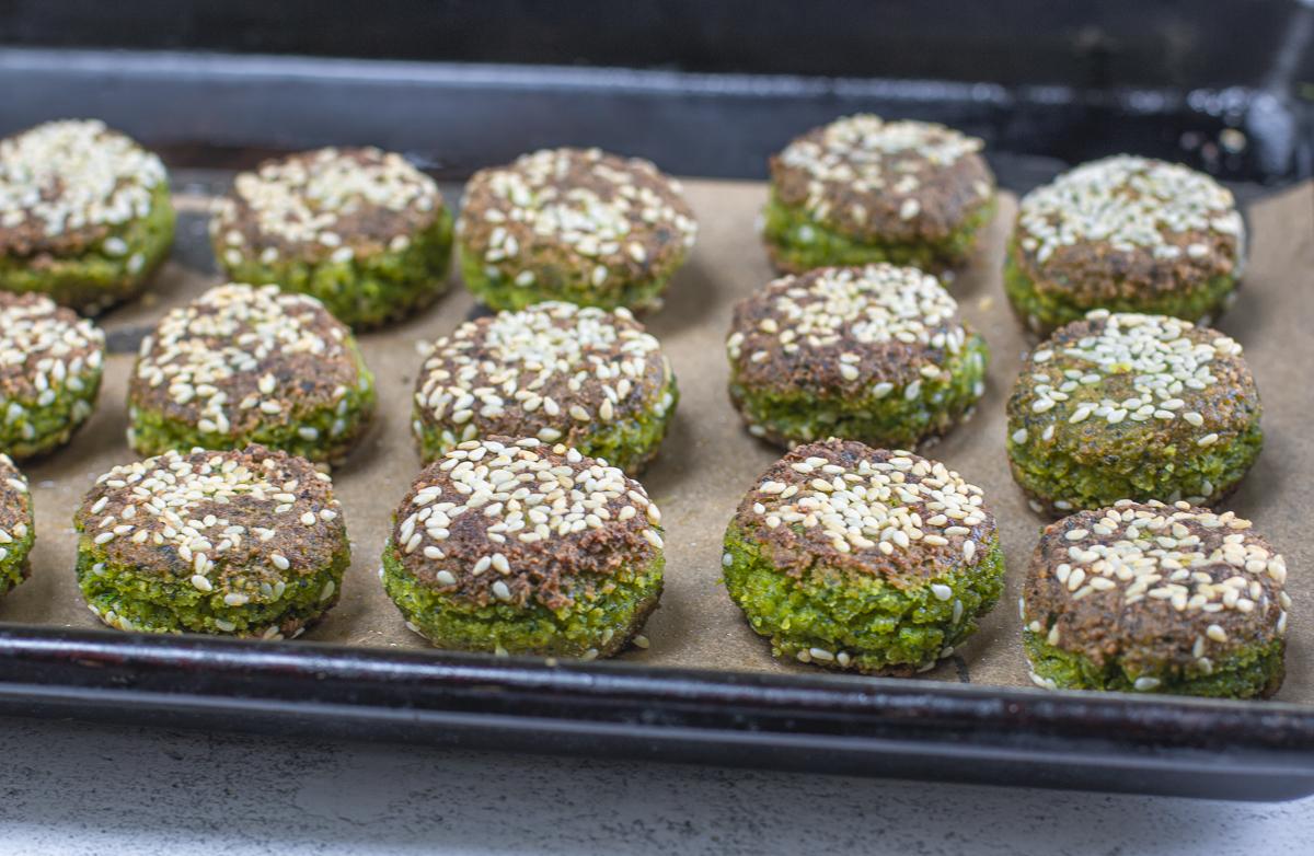 Cooked falafel on a baking pan