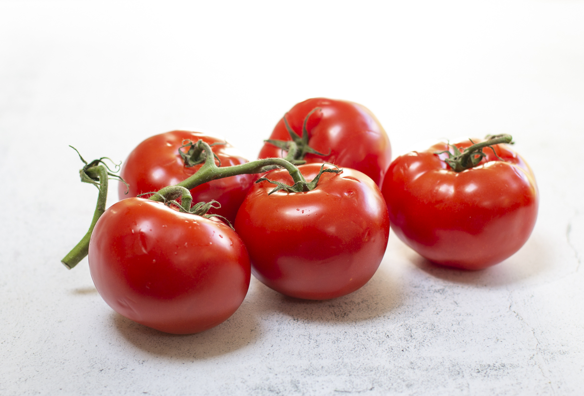 Ripe tomatoes on the vine for the Tomato Jam