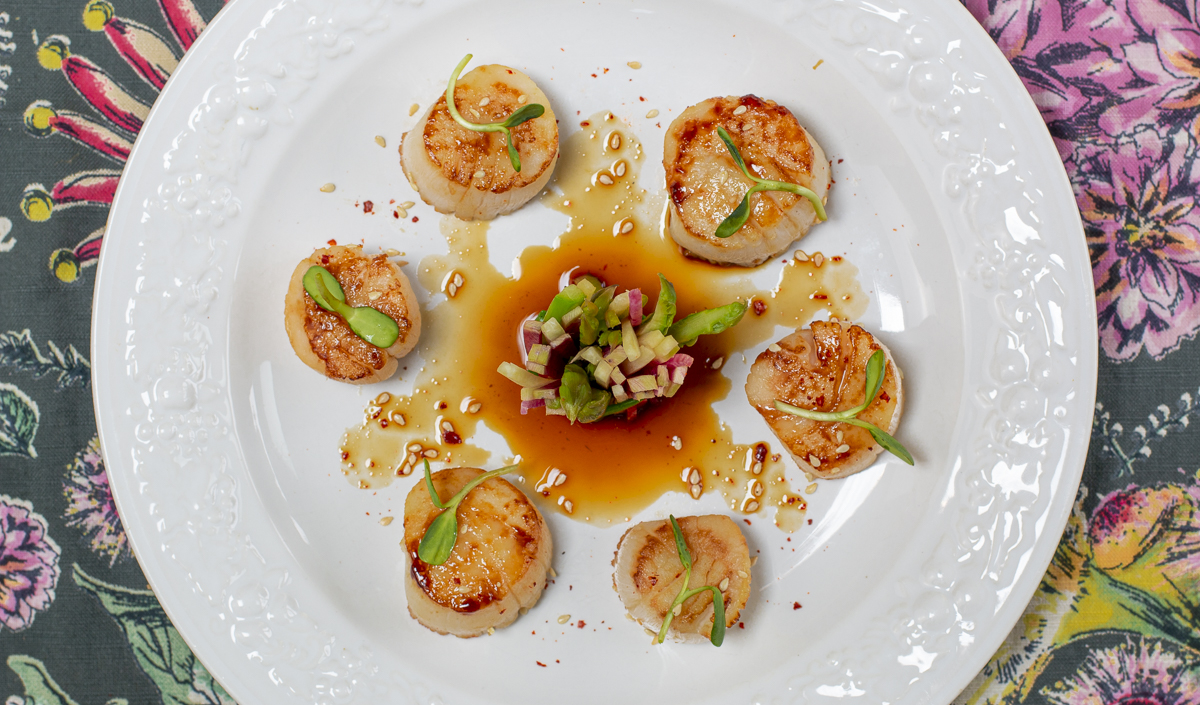 Seared Scallops with Karen's Zesty Ponzu Sauce on embossed white plate