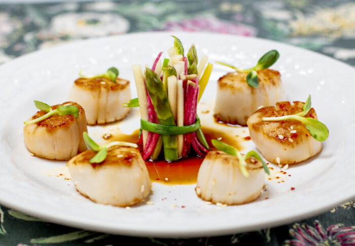 Seared Scallops with Karen's Ponzu Sauce on white embossed plate