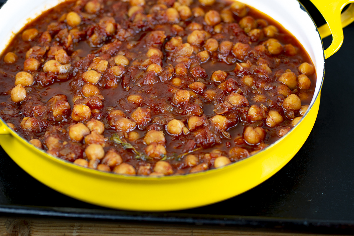 Add chickpeas in sauce to a baking dish - bake uncovered for 30 minutes