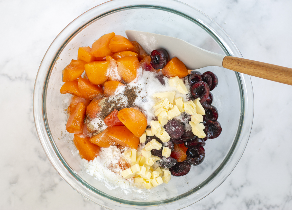Ingredients in a bowl for Apricot-Cherry fruit filling