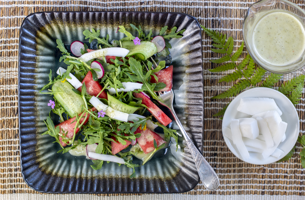 Watermelon Coconut Salad with Thai Dressing on a square plate