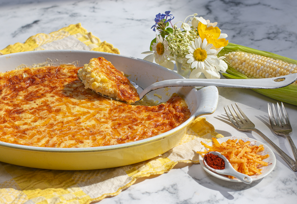 corn pudding with cheddar & chipotle crust in vintage casserole