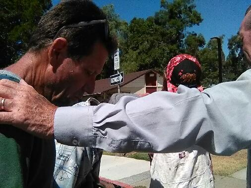 Praying while feeding the homeless