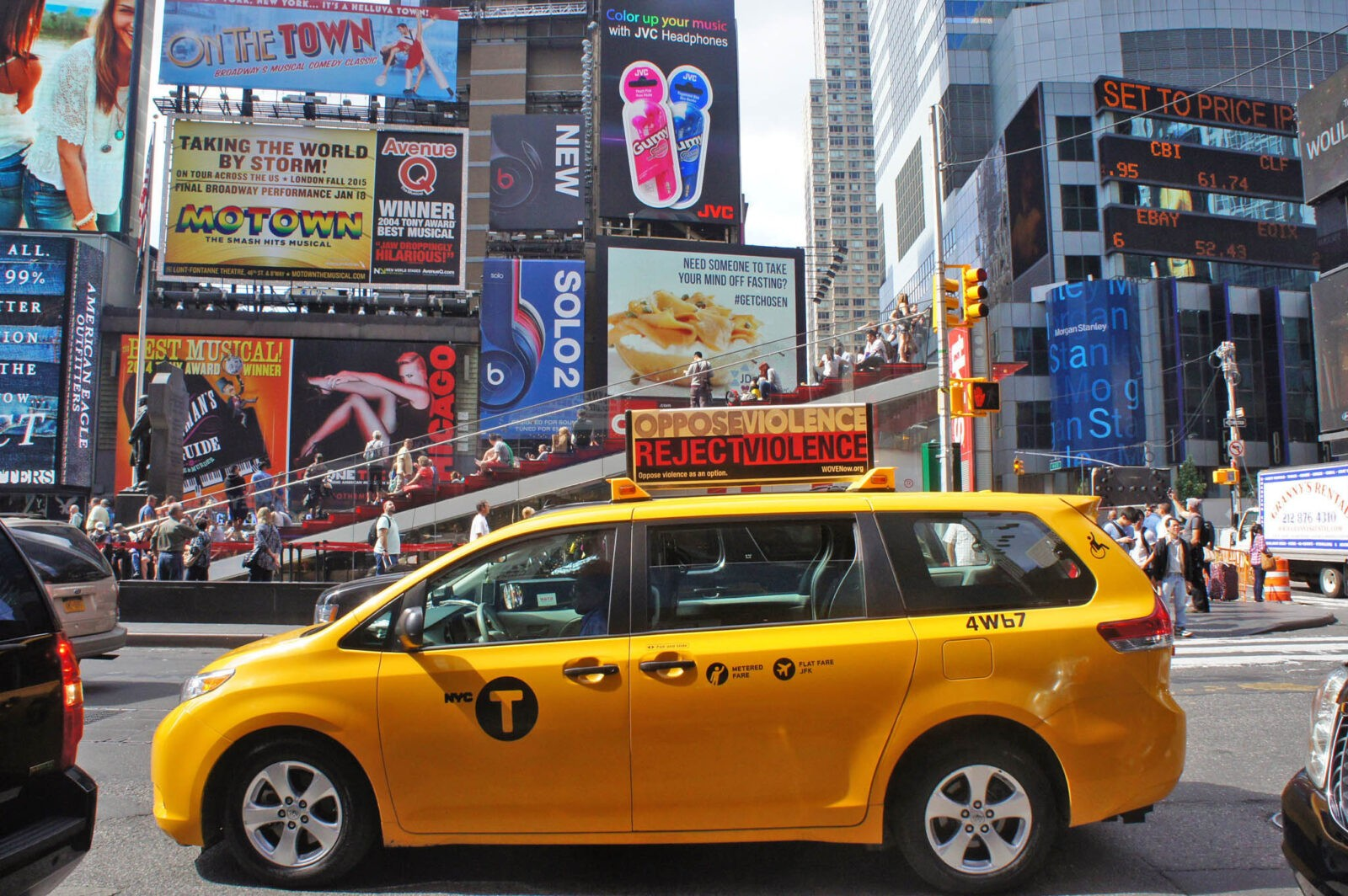 Times Square Advertising WOVEN NYC Taxi Top Campaign