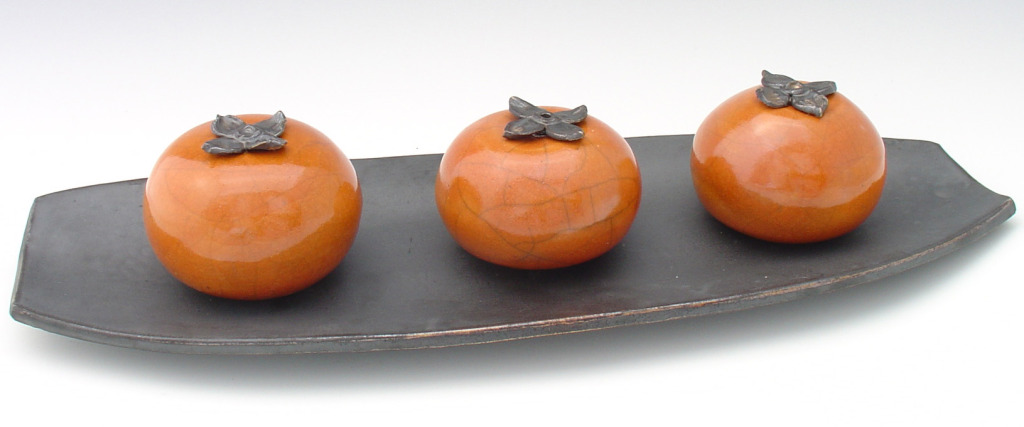 Persimmons On A Tray