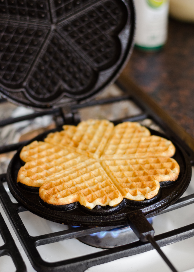 Cooking a waffle in a cast iron waffle iron.