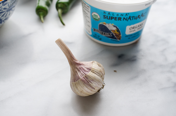 Photo of a bulb of garlic sitting on marble