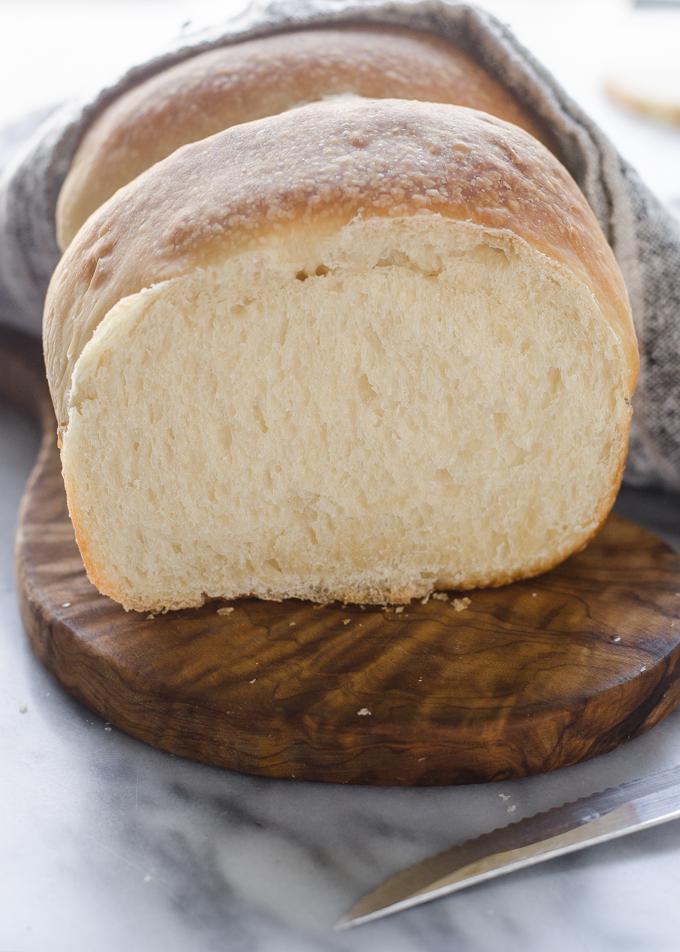 Sourdough Sandwich Bread with a slice taken out of it.
