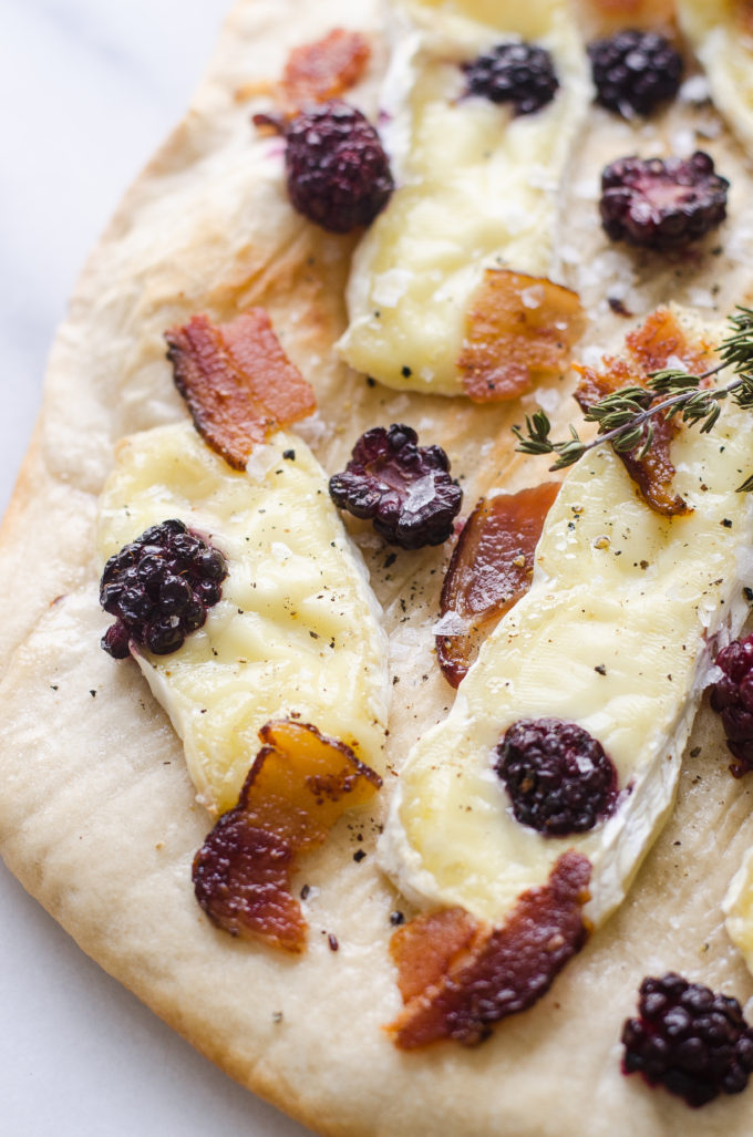 Homemade pizza with blackberries, brie, and baocn