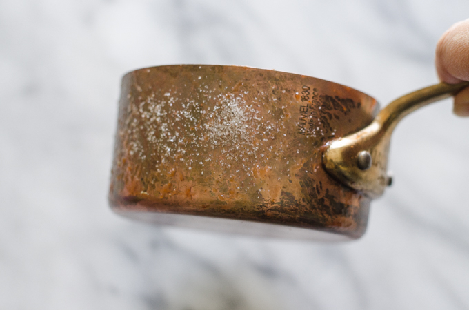 How to Polish Copper - Salt and ketchup on a tarnished copper pot.