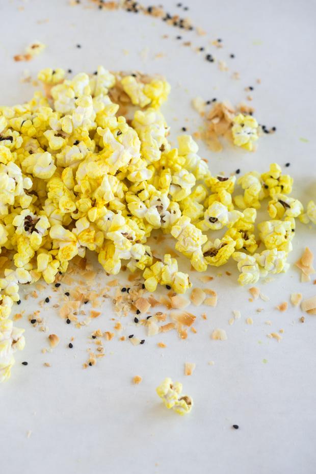 Turmeric popcorn on a light backbround.