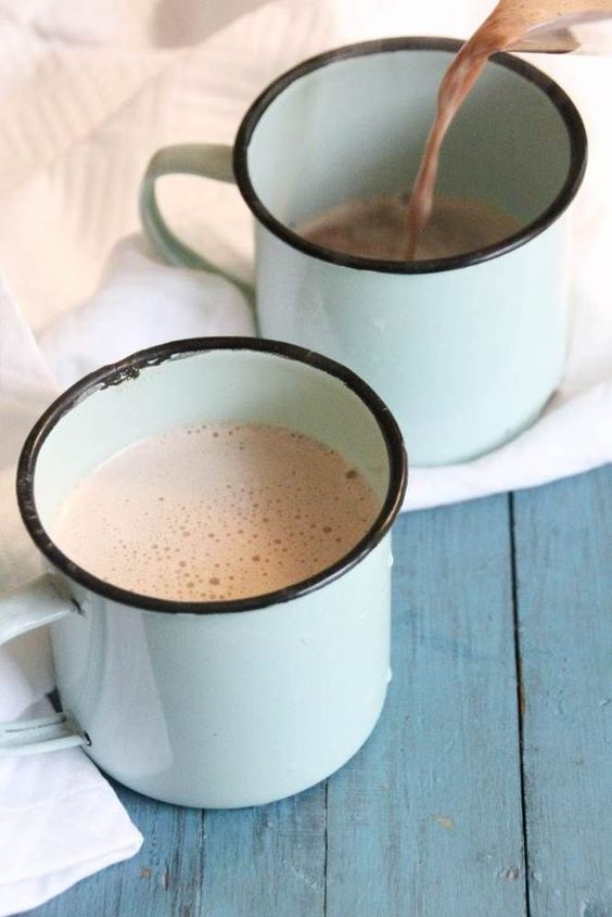 Coconut oil recipes: Mugs of cocoa, pouring into one.