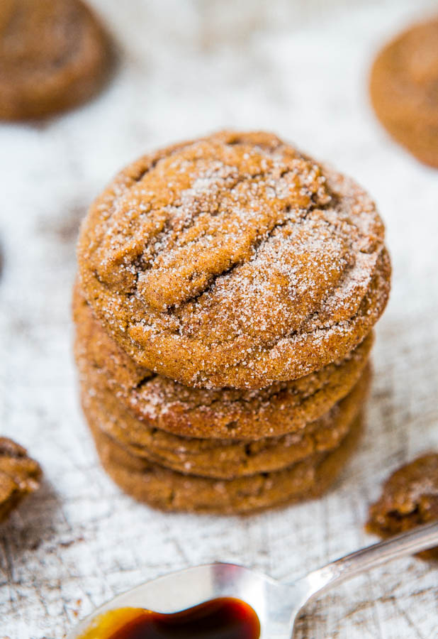 Stack of molasses spice cookies on a light background.