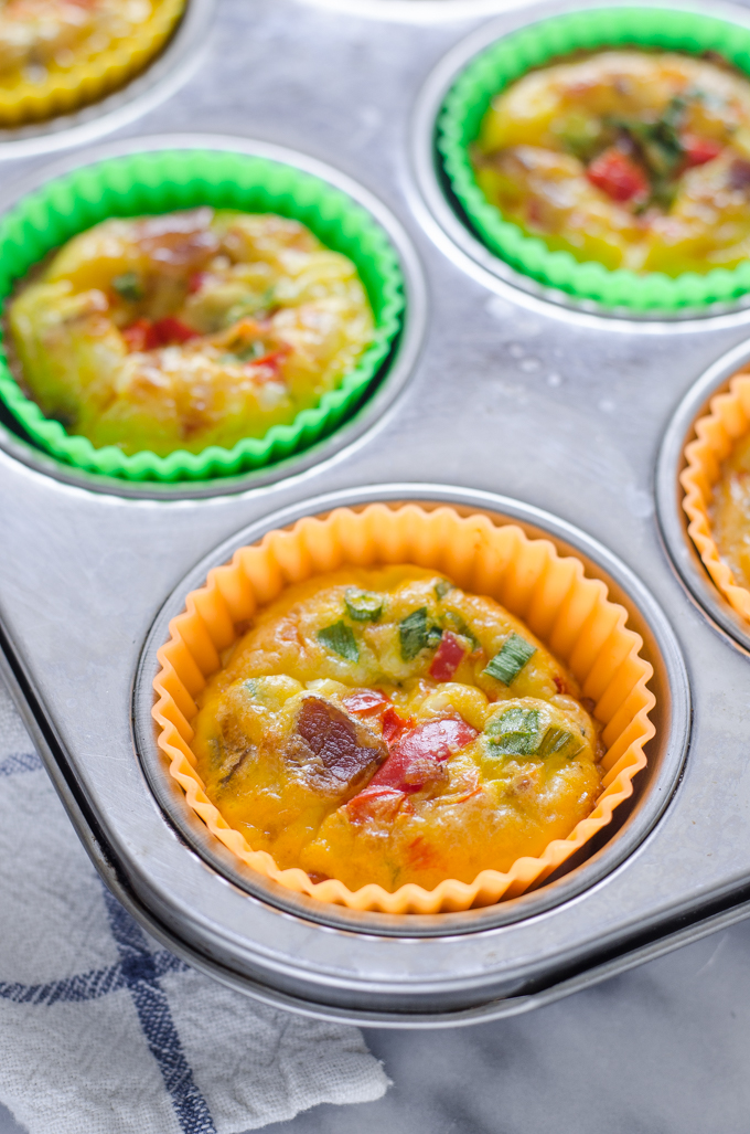 Baked egg muffin cups in the pan.