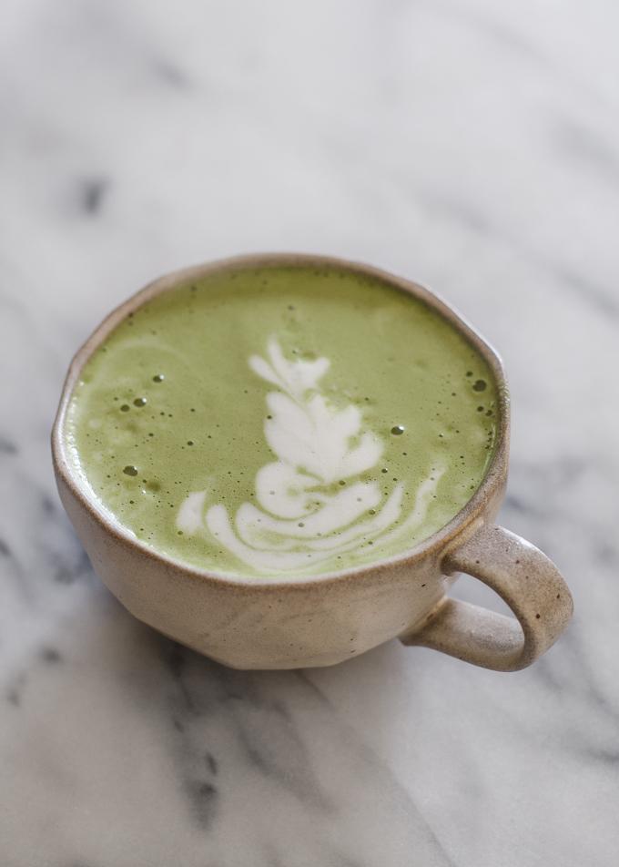 Matcha latte in a stoneware mug with latte art.