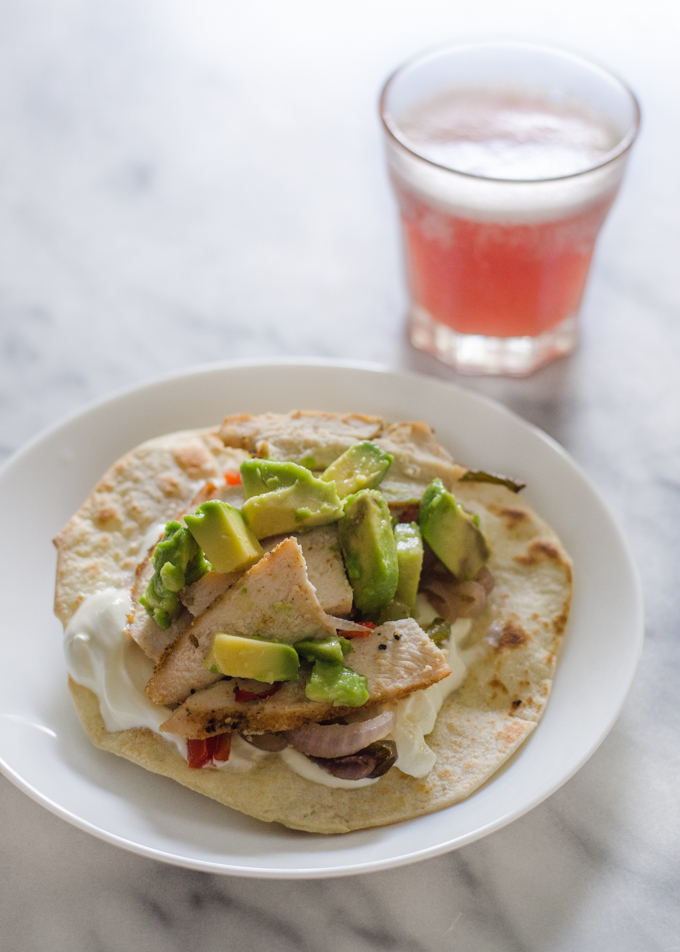 What I Ate Wednesday: supper! A chicken fajita with a glass of pink kombucha in the background.