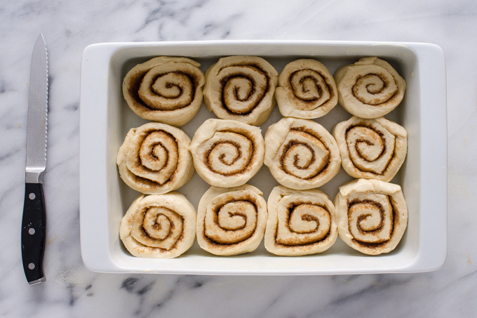 The rolls in a white baking dish.