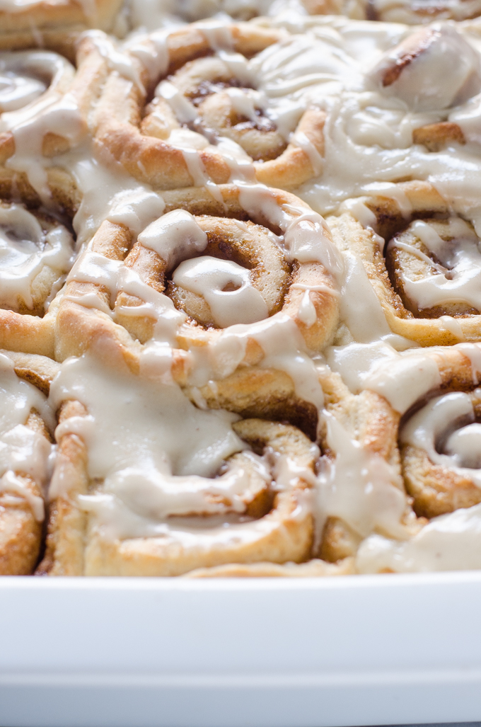 Close up shot of the finished eggnog cinnamon rolls in the pan.