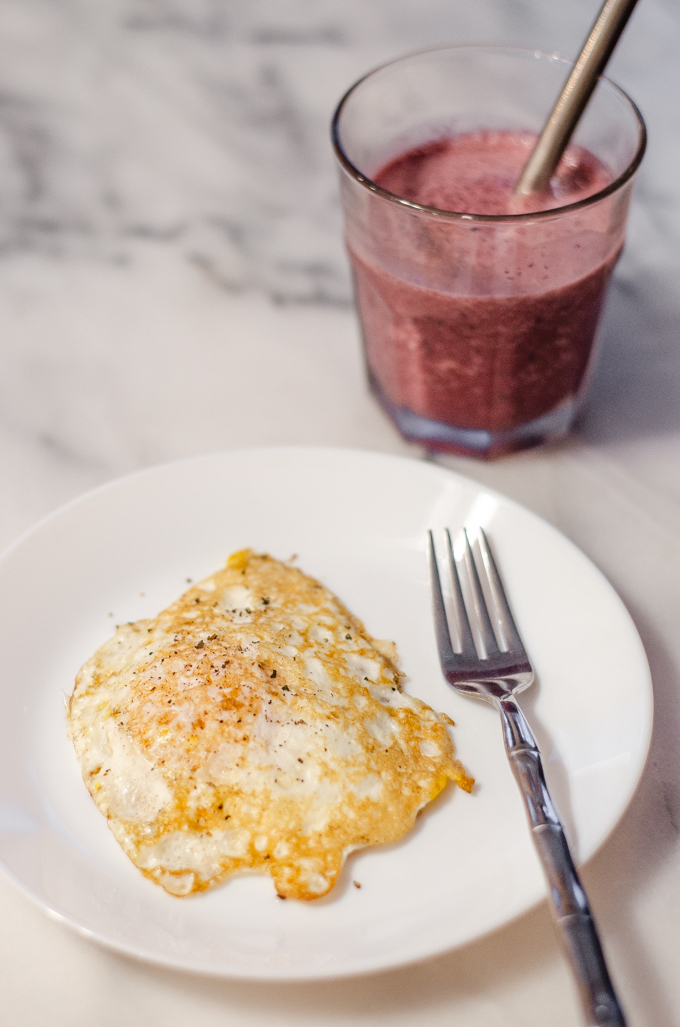 Breakfast: a fried egg and a cherry smoothie.