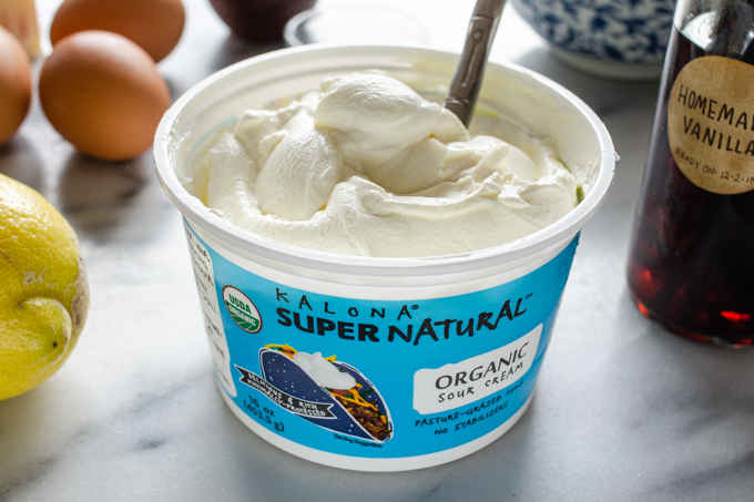 An open tub of Kalona SuperNatural sour cream.