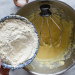 Adding the flour mixture to the batter.