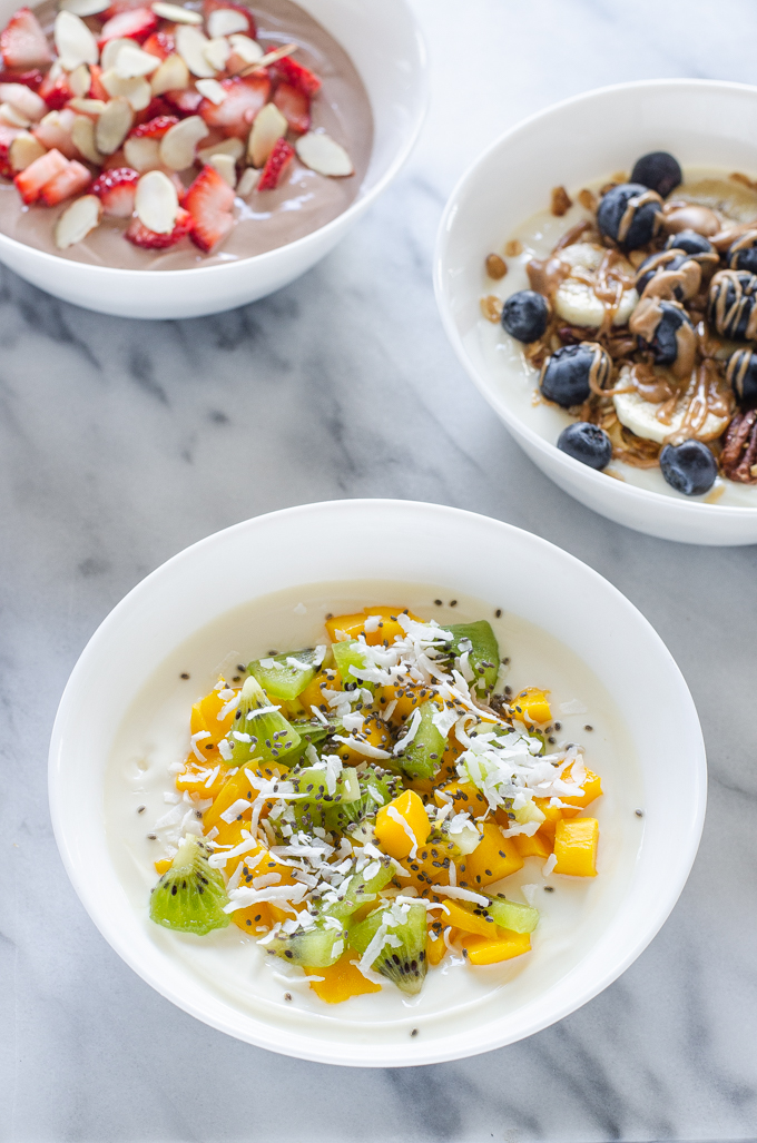 Three ideas for yogurt bowls: granola, chocolate, and tropical!