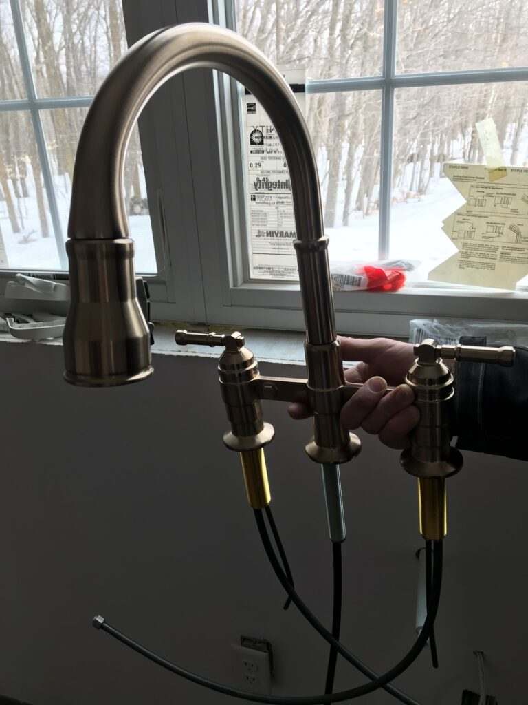 Delta broderick pull down bridge kitchen faucet.