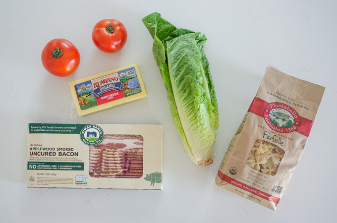 All of the ingredients needed to make BLT bowtie pasta salad.