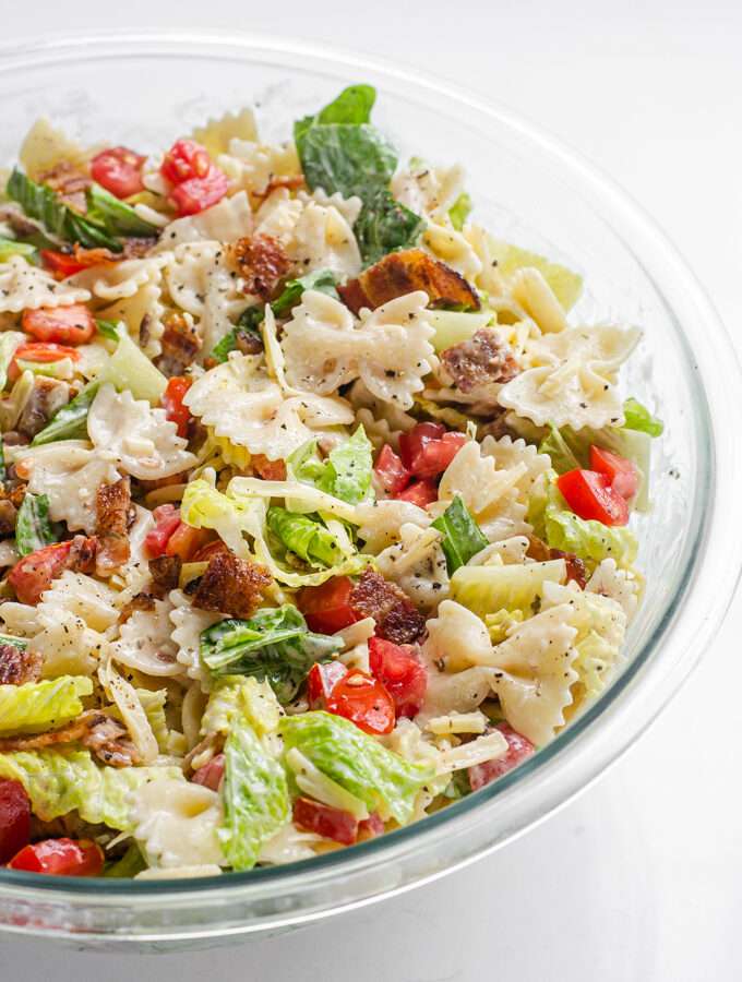 A large bowl of BLT bowtie pasta salad.