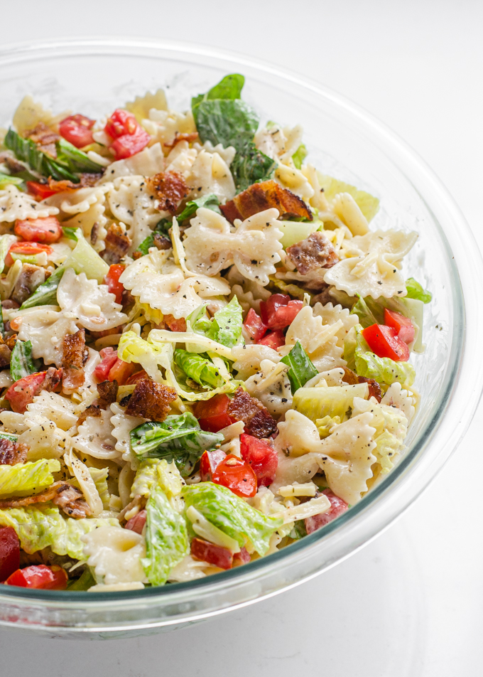 A large bowl of BLT bowtie pasta salad.