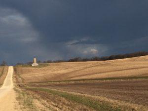 Dark clouds over farmland.