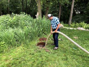 Man pumping septic system