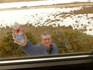 Man holding BirdStop can.