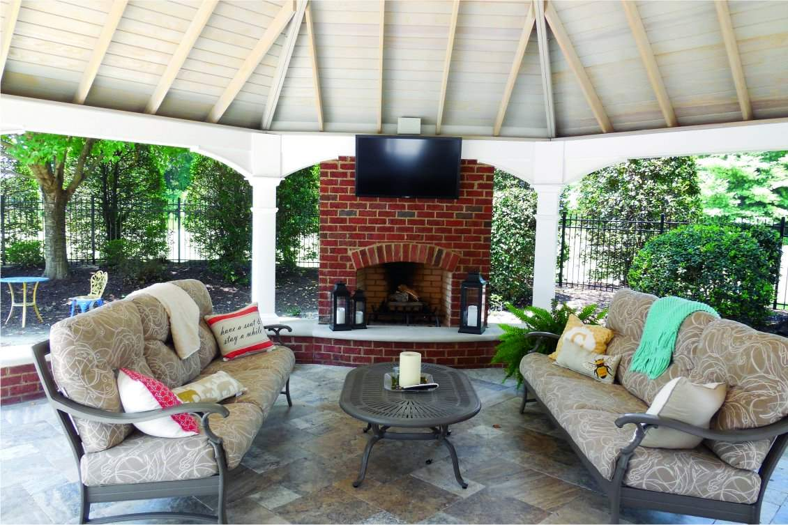 Inside the 25' custom hybrid pergola gazebo with fireplace