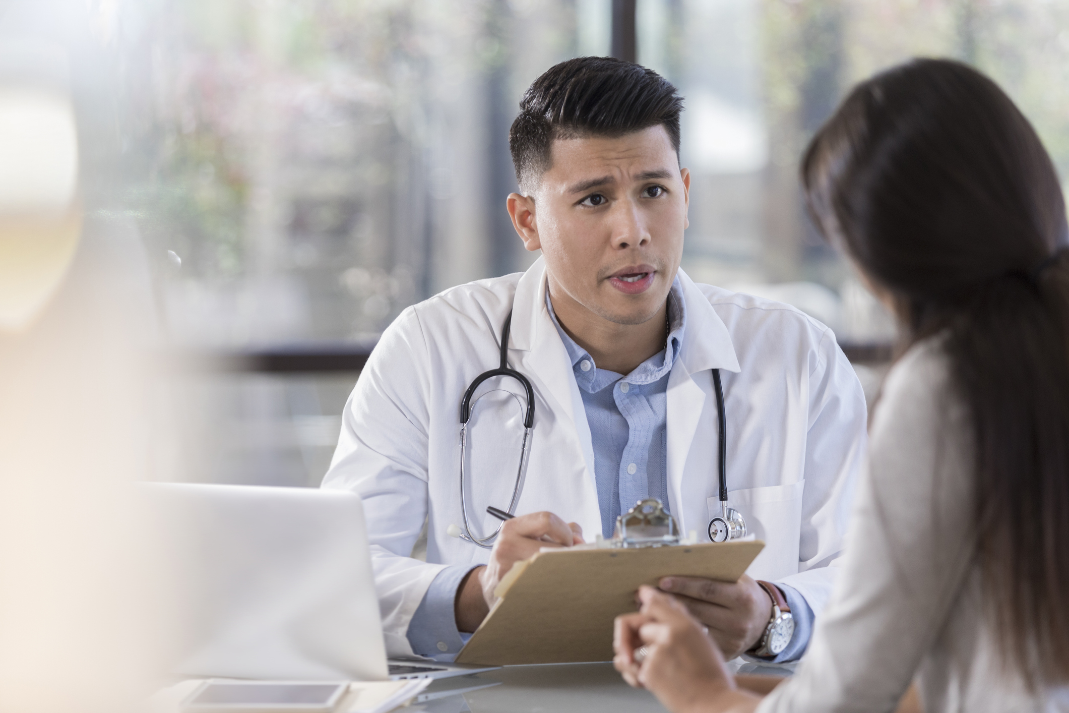 Physician discusses diagnosis with patient's parents.