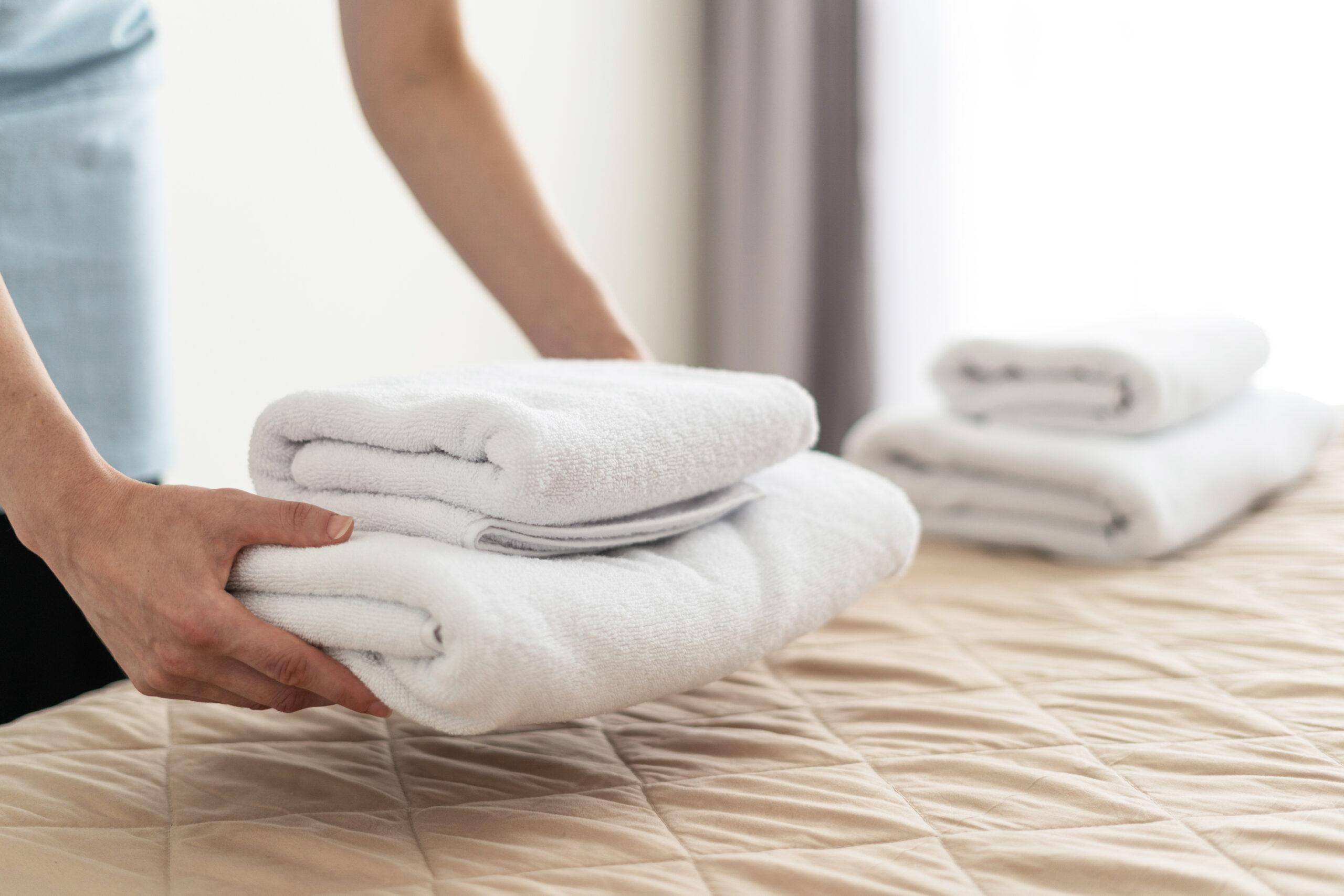 Housekeeper replacing linens