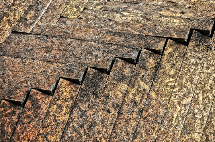 An example of a buckled wood floor.