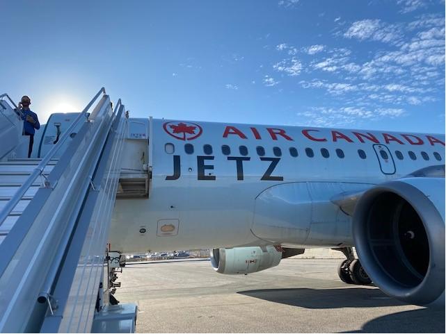 boarding the Air Canada Jetz aircraft