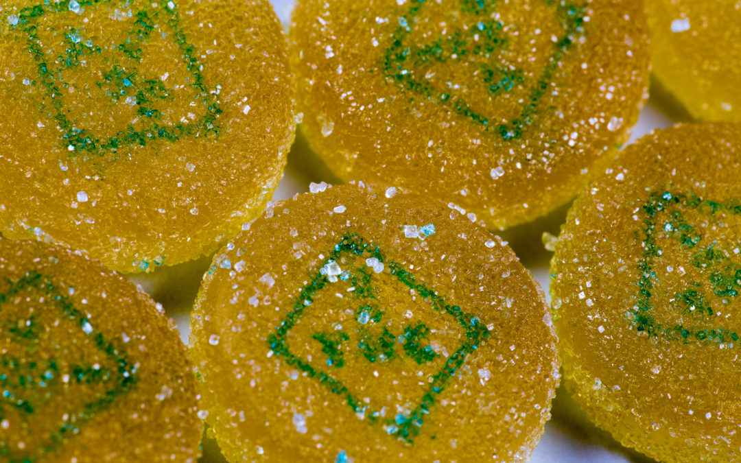 Cluster of marijuana edibles with THC symbol on them