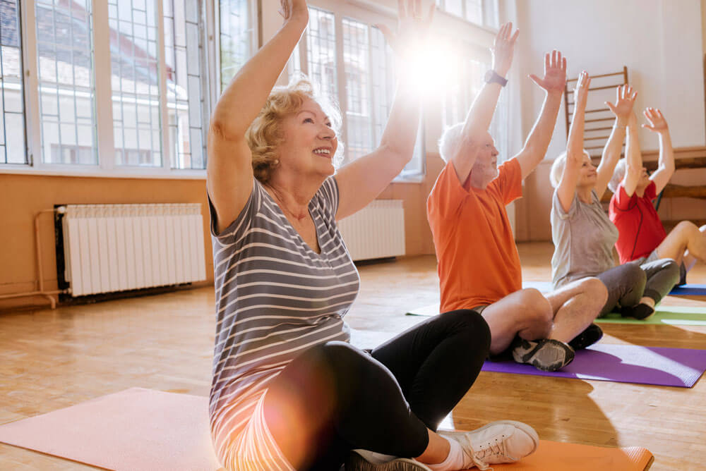 group of cheerful seniors having fun together exercising