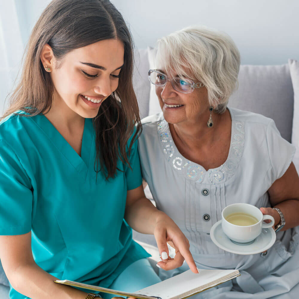 Caregiver assisting client at home