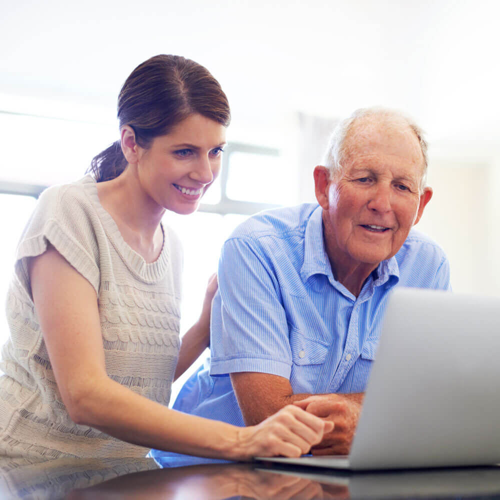 Father and daughter researching home care websites