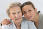 Closeup of client and caregiver