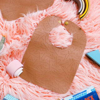DIY leather bib flatly on pink background