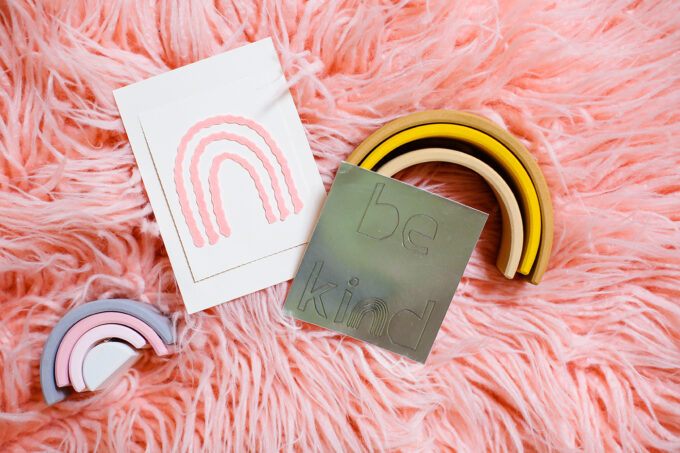 cards laying on pink fur background flatly